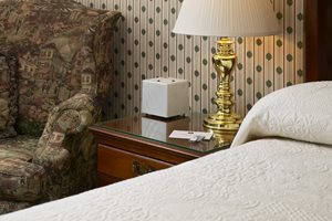 Portable odour control and ambient scenting solutions for guest rooms